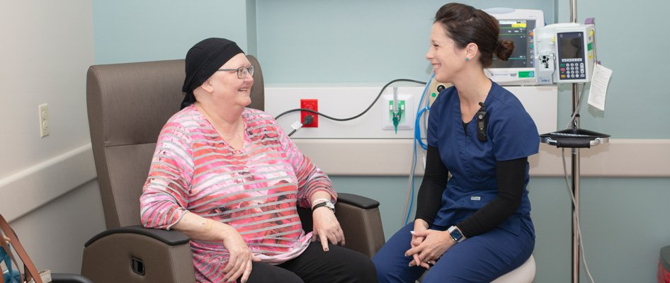 Infusion patient talking with nurse