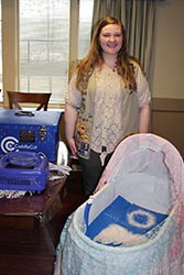 Alexandra Reeves with the Cuddle Cot she Donated
