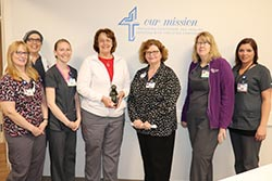 Karen Westercamp, Daisy recipient with Chief Nursing Officer, Deb Willyard, and Obstetrics staff
