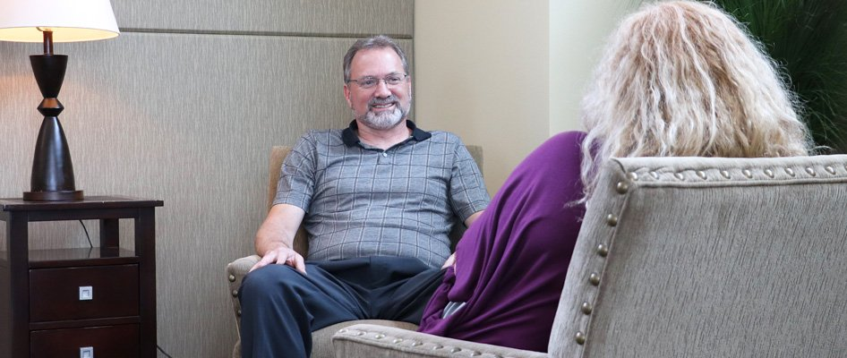 Mental health counselor, Charles Ingle, meeting with patient