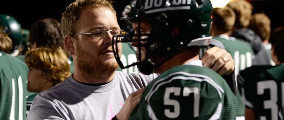 Athletic Trainer tending to a Pella football player