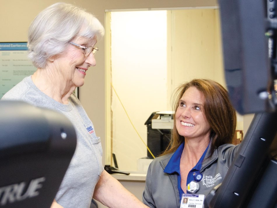 Cardiac Rehab nurse working with a patient on the treadmill